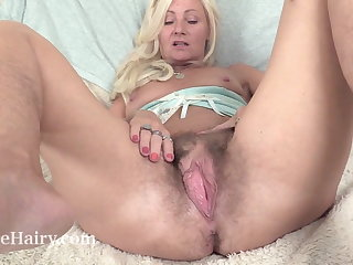 Hardcore Ellen B relaxes with her purple toy and orgasms