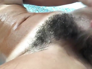 Piercing Tanned hairy girl bathing.