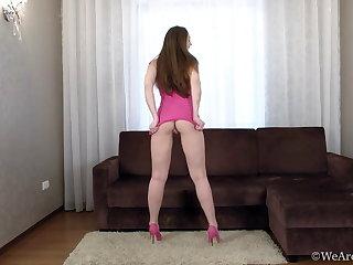 Ukrainian Beautiful hairy Cherry Bloom masturbates on her brown couch